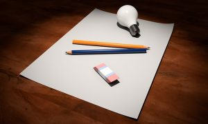 Blank paper, pencil, lightbulb, eraser